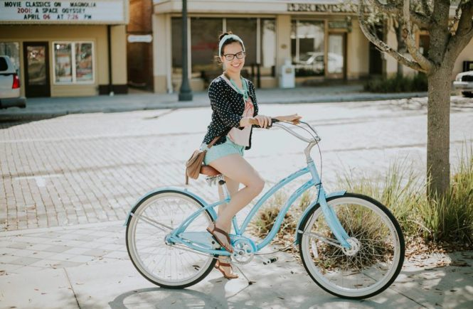 Sumalee Eaton on bicycle in Downtown Sanford