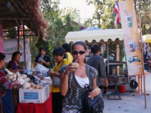 Sumalee in Thailand drinking coconut juice
